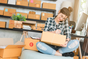 Women Packing eCommerce Items - DTC Brand Trends izest Marketing